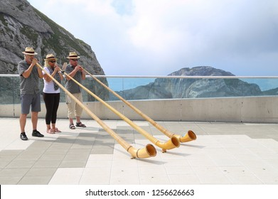 Lauterbrunnen, Switzerland. July 25, 2018.  Swiss Alphorn players on Pilatus mountain peak playing horn for tourist.
