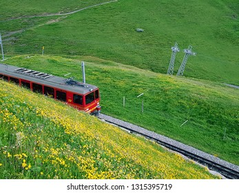 Lauterbrunnen, Switzerland - June 28 2017: Class red train that leads up to Jungfraujoch