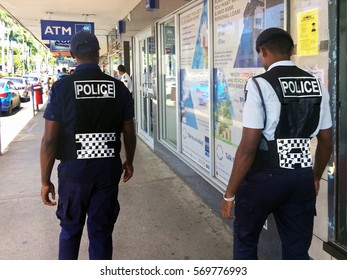 LAUTOKA, FIJI -  DEC 30 2016:Fijian police officers patrolling in the main street. The Fiji Police Force annual statistics reveal an 18% increase in crime cases in 2015.