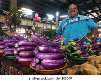 LAUTOKA, FIJI -  DEC 30 2016:Indigenous Fijian man sells Eggplants in Lautoka Market, Fiji. Fijian Eggplant exports exceeded papaya sales for the first time ever in 2015.