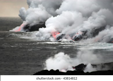 Lava erupting into Pacific Ocean during evening on Big Island