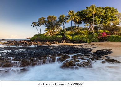 Lava Falls of Pa'ako Cove in South Maui, Hawaii. Waves crashing on lava rocks on this idyllic beach.