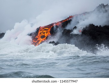 Lava flow into the ocean, with steam and haze. Spring 2018 eruption of Kilauea on the Big Island of Hawaii.