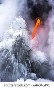 A lava flow on the big Island of Hawaii known as the fire hose spews out molten magma from Kilauea Volcano into the ocean, causing explosions and forming dangerous gasses.
