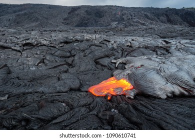 Lava flow from Puu Oo in Kalapana, Big Island, Hawaii. Pali in the background.