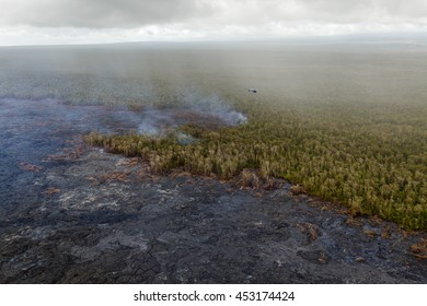 Lava from the Kilauea crater of Puu Oo burning the hawaiian rain forest, aerial photograph from a helicopter, Big Island, Hawaii.