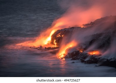 Lava from the Kilauea volcano, flows into the Pacific ocean near Kalapana, after sunset at Volcanoes National Park on the Big Island of Hawaii.