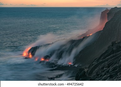 Lava from the Kilauea volcano, flows into the Pacific ocean near Kalapana, while people watch the spectacle from up above at Volcanoes National Park on the Big Island of Hawaii.
