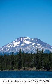 Lava Lake, along the Cascade Lakes Scenic Byway near Bend Oregon, with Mt. Bachelor in the background. Negative space
