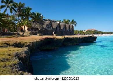 Lava rock shore and white sand beach at Varadero Cuba resort hotel Varadero, Cuba - April 3, 2014