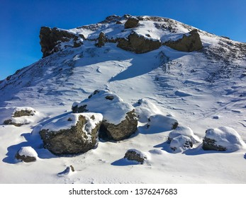 Lava rock an snow in Raudholar in Iceland at wintertime at sunny day