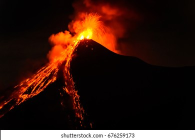 Lava spurts from erupting Fuego volcano near Antigua, Guatemala, Central America