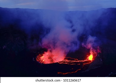 Lava and steam in crater of Nyiragongo volcano in Virunga National Park in Democratic Republic of Congo, Africa