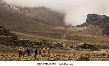 Lava tower. A group of tourists leads the way to the top of Kilimanjaro