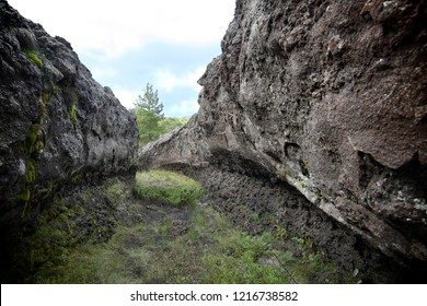 lava tube is natural conduit formed by flowing lava in Etna Park, Sicily