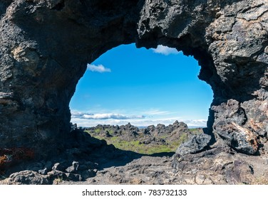 Lava window at Dimmuborgir, Myvatn area - Iceland. The Dimmuborgir area is composed of various volcanic caves and rock formations, reminiscent of an ancient collapsed citadel.