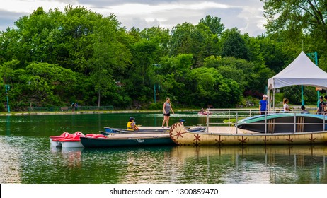 Laval, Canada - June 20 2018: Boats in lake in Park of Nature in Laval