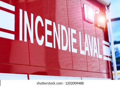 Laval, Canada: October 13, 2018: French inscription on the car – Incendie Laval. The car of the Canadian Fire Department from Laval. Fire extinguishers emergency service in Quebec province.