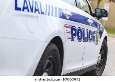Laval, Quebec, Canada: May 19, 2018. A real police car of the municipal police department in Laval town, during operative intervention. Inscriptions on the car – Police.