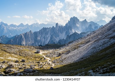 "Lavaredo refuge and of the Cristallo Mountain grop taken from the foot of the ""Tre Cime di Lavaredo"" (Drei Zimmen) on a nice clear day with few clouds over the dolomiti peaks"