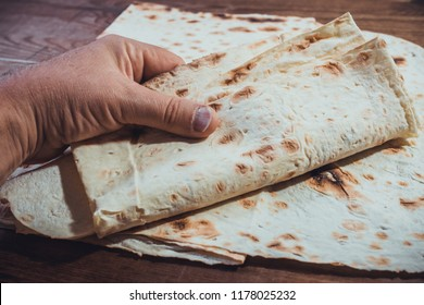 Lavash in the man's hand