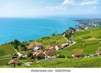 Lavaux, Switzerland - August 30, 2016: Village at Lavaux Vineyard Terraces hiking trail, Lake Geneva and Swiss mountains, Lavaux-Oron district, Switzerland