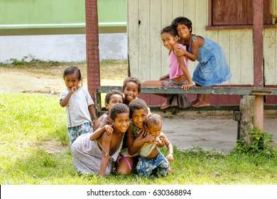 LAVENA, FIJI - NOVEMBER 27: Unidentified children play in Lavena village on November 27, 2013 on Teveuni island, Fiji. Taveuni is the third largest island in Fiji.