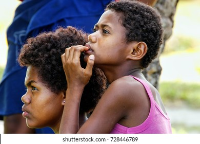 LAVENA, FIJI - NOVEMBER 27: Unidentified women sit outside on November 27, 2013 in Lavena village on Teveuni island, Fiji. Taveuni is the third largest island in Fiji.