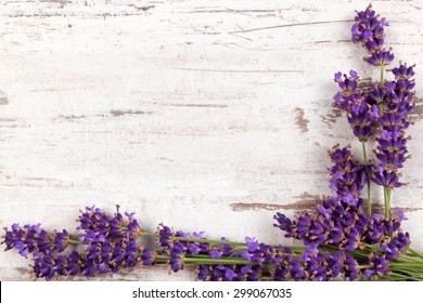 Lavender background. Lavender on white wooden antique textured background, top view, provence style.