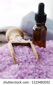Lavender bath crystals and a dropper bottle of lavender oil