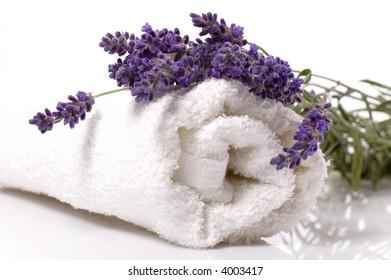 lavender bath items. salt, towel, and fresh flower