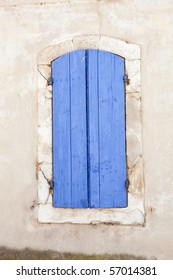 Lavender blue colored shutters on old window in historic city of Arles, southern France