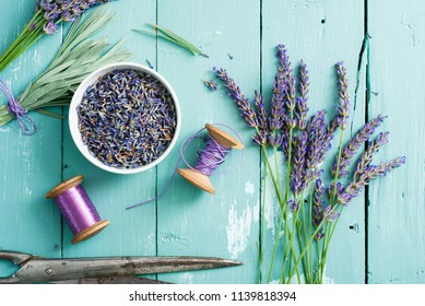lavender bouquet arrangement, flower cutting with old scissors on blue wooden