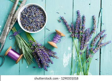lavender bouquet arrangement, flower cutting with old scissors on blue wooden