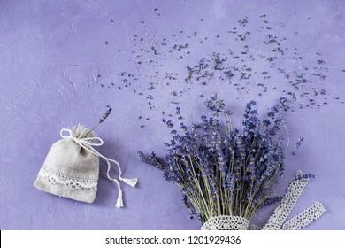 lavender bouquet on a purple background, a lavender linen bag and lace ribbon - sachet background