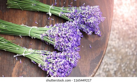 Lavender bouquet on wood table top view angle at Furano Hokkaido Japan which flowers are full bloom and have a great fragrance of aroma for relaxing moment.