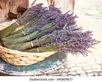 Lavender bouquets - bunches of violet flowers into a wicker basket. Rural scene in French village with lavender flowers for decoration background in Provence style.
