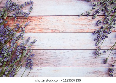Lavender. Lavender branches on a wooden background. Festive postcard.