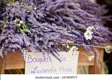 Lavender bunches selling in an outdoor french market. Horizontal shot with selective focus