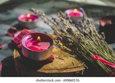 Lavender and candles on a black background