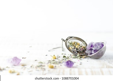 Lavender and Chamomile loose tea herbs on white wash wooden background