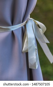 Lavender colour curtain tied with white ribbon