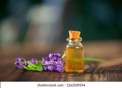 lavender essential oil in a beautiful bottle on the table