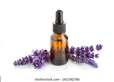 Lavender essential oil in glass bottle with dropper isolated on white background