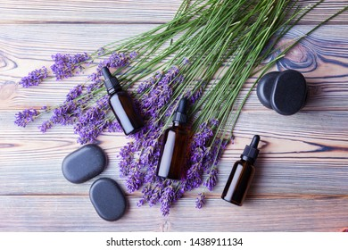 lavender essential oil on white wood - beauty treatment