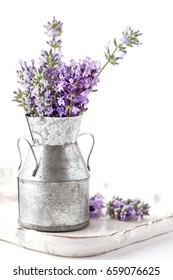 Lavender flower bouquet in a tin can vase. Isolated on white background.