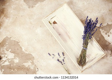Lavender flowers bouquet overhead on textured background, vintage toning