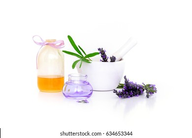 lavender flowers, lavander extract, oil and montar with dry flowers isolated on white.
