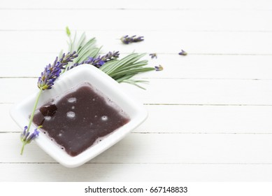 lavender flowers and liquid soap on white wood table background