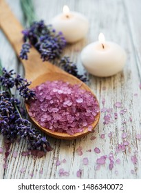 Lavender flowers and natural sea salt on a old wooden   background